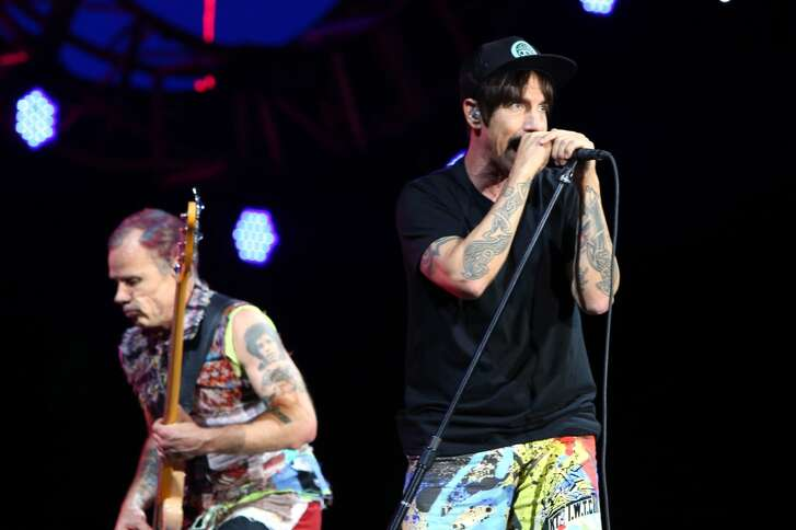 Recording artists Flea (L) and Anthony Kiedis of Red Hot Chili Peppers perform on the Samsung Stage at Lollapalooza 2016 - Day 3 at Grant Park on July 30, 2016 in Chicago, Illinois.