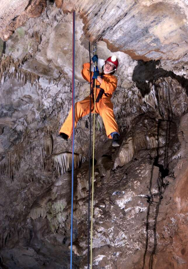 Tina Suttman hangs in the air in Moaning Cavern — at 180 feet deep the largest single cave chamber in California. Photo: Bill Becher