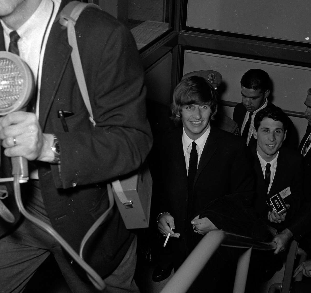 Bedlam at San Francisco International Airport as Ringo Starr of the Beatles stops here to change planes on his way to Australia to rejoin his band mates on their Australian tour