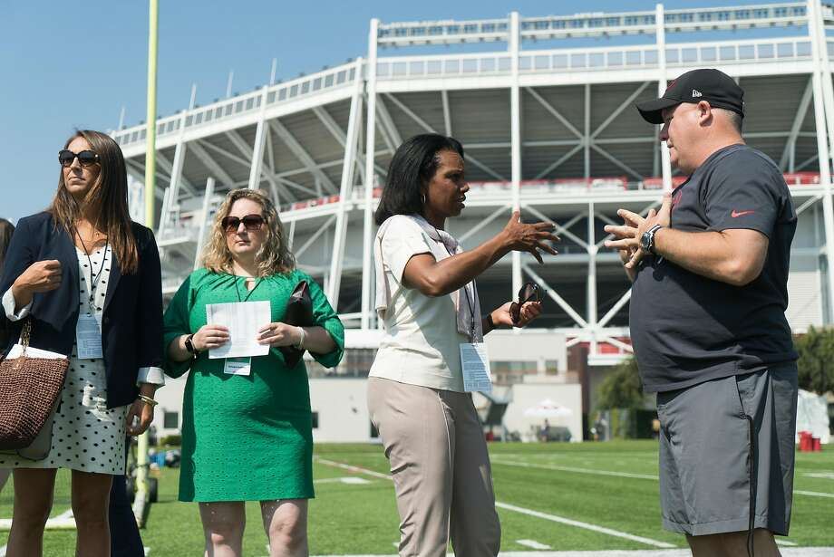 Condoleezza Rice speaks with others during a 49ers practice at Levi's Stadium on Monday, Aug. 1, 2016. Photo: James Tensuan, Special To The Chronicle