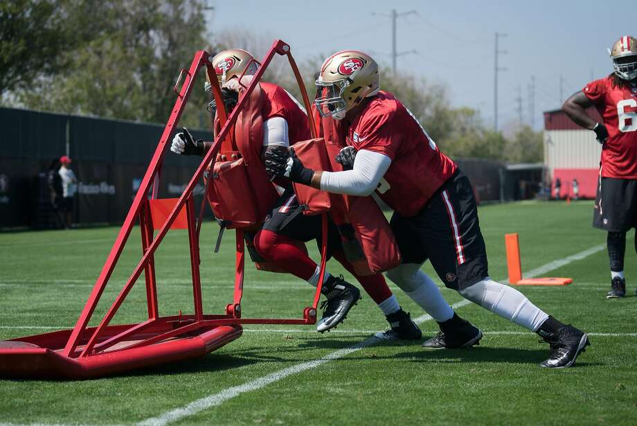 #65 Joshua Garnett runs a drill during a 49ers practice at Levi's Stadium on Monday, Aug. 1, 2016. Photo: James Tensuan, Special To The Chronicle