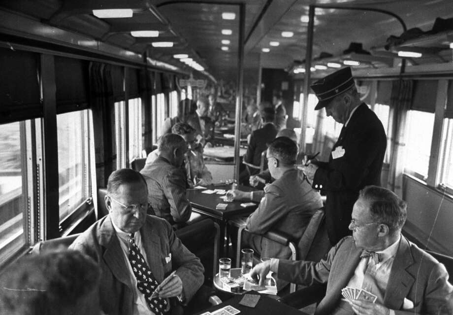 Legendary LIFE magazine photographer Peter Stackpole documented the Gold Coast Club cars and smokers filled with paper-reading, bridge-playing commuters on way home to Connecticut from business in New York City, 1948. Photo: Peter Stackpole/The LIFE Picture Collection