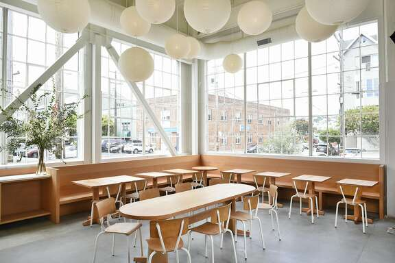 The main dinning area with wood worked tables and chairs and hanging paper lights at Tartine Manufactory, in San Francisco, CA Sunday, July 31, 2016.   Tartine Manufactory is a new restaurant and bakery from Elisabeth Prueitt and Chad Robertson, the couple behind Tartine Bakery, and is housed in the Heath Ceramics building in San Francisco.