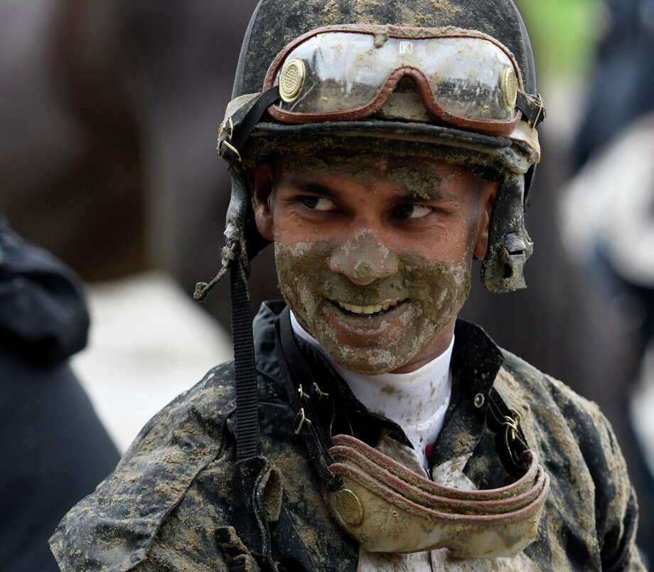 Jockey Shaun Bridgmohan wears a smile and a face full of mud after riding in the second race Sunday on a very muddy day July 31, 2016 at the Saratoga Race Course in Saratoga Springs, N.Y.    (Skip Dickstein/Times Union ORG XMIT: J=0801_trackmud Photo: SKIP DICKSTEIN, Albany Times Union