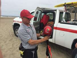 Sean Scallan (red cap) and James Mathews of the Beach Patrol on Aug. 1, 2016