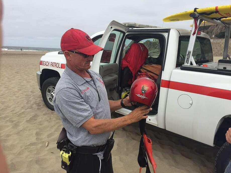 Sean Scallan (red cap) and James Mathews of the Beach Patrol on Aug. 1, 2016 Photo: CW Nevius, San Francisco Chronicle