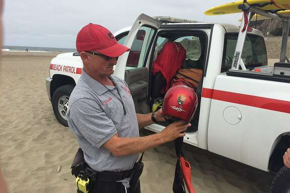 Sean Scallan (red cap) and James Mathews of the Beach Patrol on Aug. 1, 2016