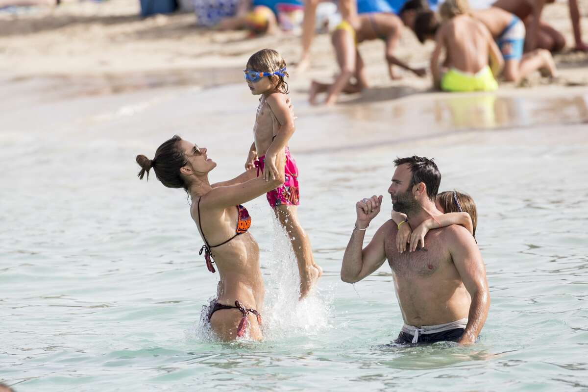 Alessandra Ambrosio and Jamie Mazur enjoy a family day on the beach