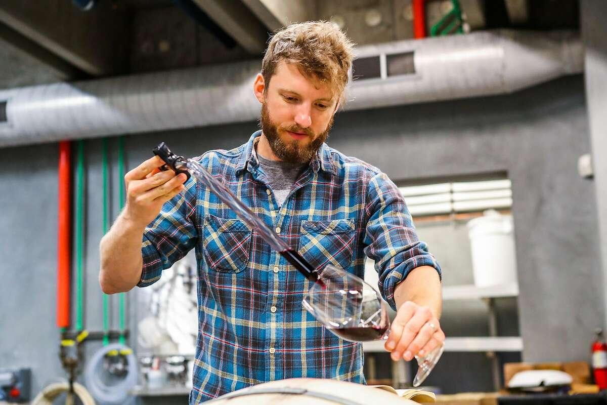 Winemaker Scott Young pours wine from a thief into a wine glass, during a portrait at Young Inglewood winery, in Napa, California, on Saturday, July 30, 2016.
