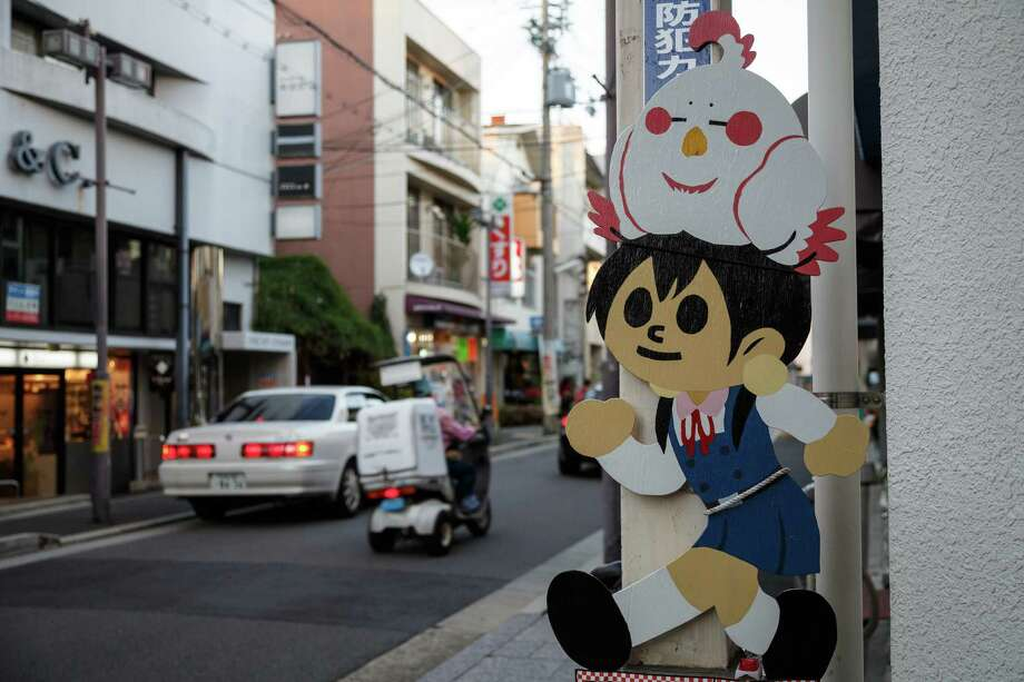 """Fan art from the anime series """"Tamako Market"""" appears on a street in Kyoto, Japan, in 2014. Photo: Michael Vito, HONS / Michael Vito"""