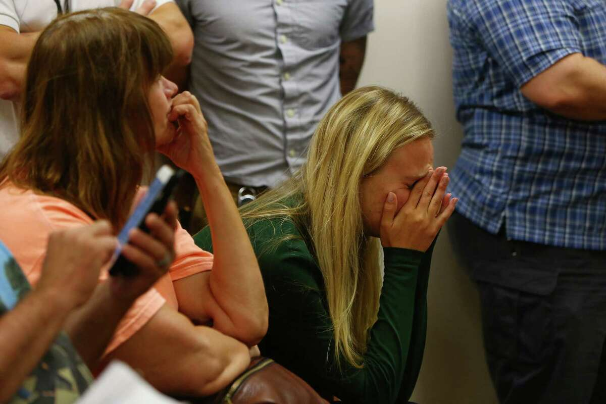 A friend of the victims, who did not wish to give her name, becomes emotional during a bail hearing for Mukilteo shooting suspect Allen Ivanov the Snohomish County Courthouse, Monday, August 1, 2016. Ivanov, 19, is being investigated on two counts of first-degree murder and one count of domestic violence aggravated first-degree murder after four teens were shot and three died -- including his ex-girlfriend -- at a house party in Mukilteo on Saturday, July 30, 2016. Ivanov was ordered by the judge to be held with out bail and to have no contact with the victims' families. Victims Jake Long, Jordan Ebner and Anna Bui all died from gunshot wounds, Will Kramer remain in serious condition. Ivanov was ordered by the judge to be held with out bail and to have no contact with the victims' families.