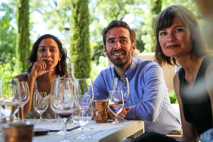 (l-r) Nandita Gupta, Teel Lidow, and Becky Jones listen to Jim Young during a tasting at Young Inglewood winery in Napa, California, on Saturday, July 30, 2016.