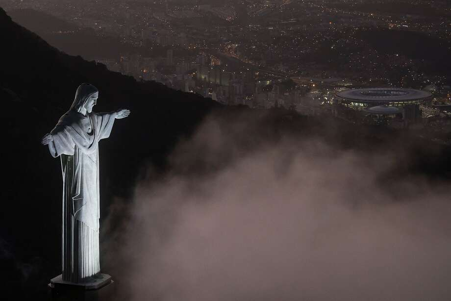 The Christ the Redeemer statue overlooks Rio de Janeiro and its famous Maracana soccer stadium, where the Summer Olympics are set to open Friday night amid concerns about health, security and infrastructure. Photo: Buda Mendes