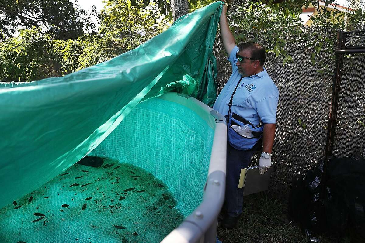 *** BESTPIX *** MIAMI, FL - JULY 30: Robert Muxo, a Miami-Dade County mosquito control inspector, inspects a property for mosquitos or breeding areas in the Wynwood neighborhood as the county fights to control the Zika virus outbreak on July 30, 2016 in Miami, Florida. There have been a reported four individuals that have been infected with the Zika virus by local mosquitoes which makes them the first known cases of the virus being transmitted by mosquitoes in the continental United States. (Photo by Joe Raedle/Getty Images)