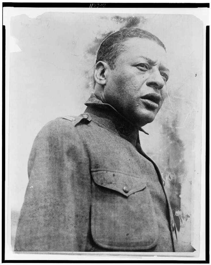 "Bert Williams, one of the most famous African American performers of his time, is shown ""singing a psalm at the first regimental open air service for the 15th Regiment of the New York National Guard, held in Olympic Field, 136th Street and Fifth Avenue, New York City."" Williams and his performing partner, George Walker, were among the top Vaudeville entertainers of the time, doing both minstrel-style shows and comedy recordings that chipped away at racial issues in subtle ways. Photo likely dates to 1916. Library of Congress. Photo: Library Of Congress"