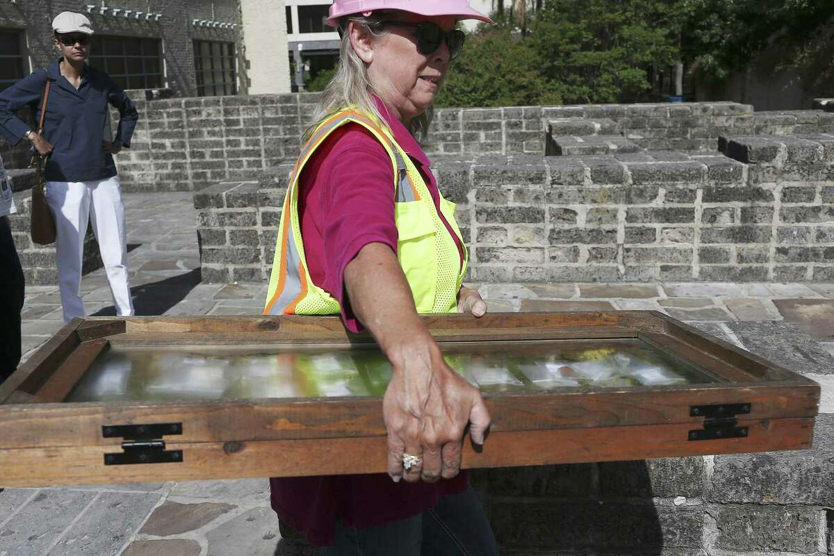 City of San Antonio Archaeologist Kay Hindes carries a case with Alamo artifacts during the daily excavation briefing at the Alamo Plaza site in August 2016. Archaeologists had found more than 300 artifacts after about two weeks of digging in Alamo Plaza, in search of the mission compound's original walls and clues to the site's long and colorful past.