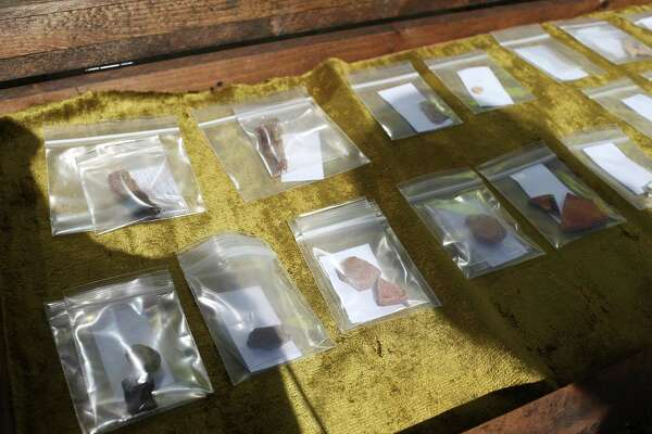 Alamo artifacts are seen inside a case during a 2016 excavation briefing at the Alamo Plaza site. Archaeologists found more than 300 artifacts after about two weeks of digging in Alamo Plaza, in search of the mission compound's original walls and clues to the site's long and colorful past.