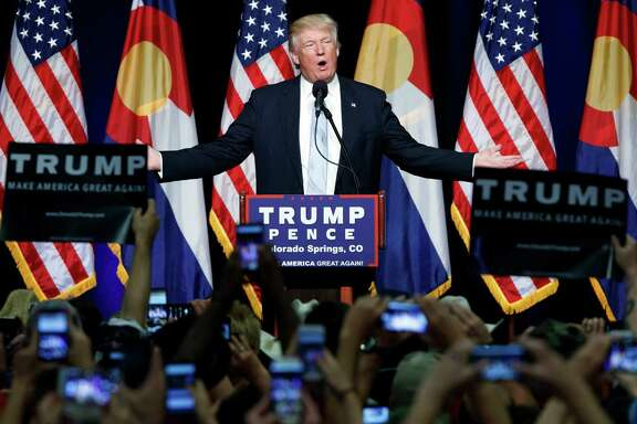 FILE - In this Friday, July 29, 2016 file photo, Republican presidential candidate Donald Trump speaks during a campaign rally in Colorado Springs, Colo. Trump broke a major American political and societal taboo over the weekend when he engaged in an emotionally-charged feud with Khizr and Ghazala Khan, the bereaved parents of a decorated Muslim Army captain killed by a suicide bomber in Iraq. He further stoked outrage by implying Ghazala Khan did not speak while standing alongside her husband at last week's Democratic convention because they are Muslim. (AP Photo/Evan Vucci, File)