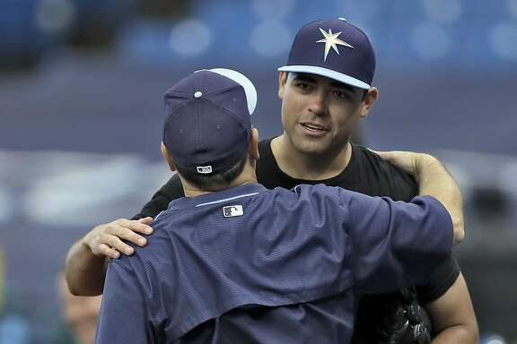 "Former Tampa Bay Rays starting pitcher Matt Moore, right, hugs video coordinator Chris ""Chico"" Fernandez after Moore was traded to the San Francisco Giants before a baseball game, Monday, Aug. 1, 2016, in St. Petersburg, Fla. (AP Photo/Chris O'Meara)"