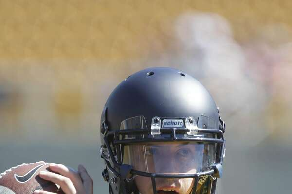 Davis Webb, Cal quarterback, works out with others on the first day of training camp at Memorial Stadium on Monday, August 1, 2016 in Berkeley California.