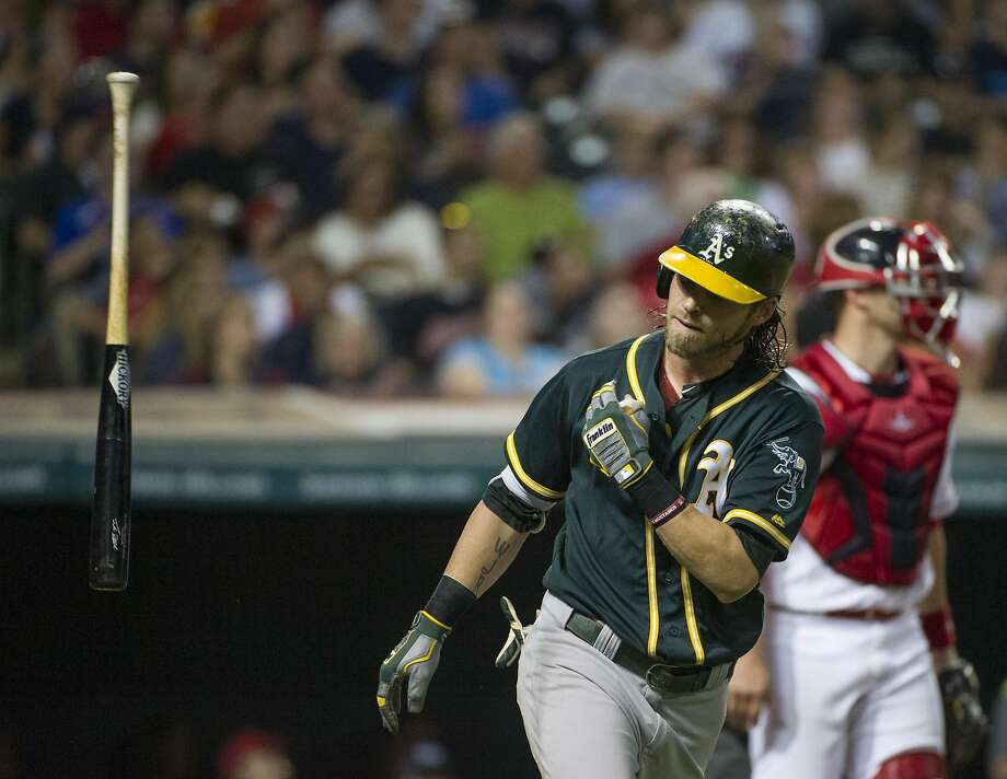 Oakland Athletics Josh Reddick flips his bat after drawing a walk against the Cleveland Indians during a baseball game in Cleveland, Friday, July 29, 2016. (AP Photo/Phil Long) Photo: Phil Long, Associated Press
