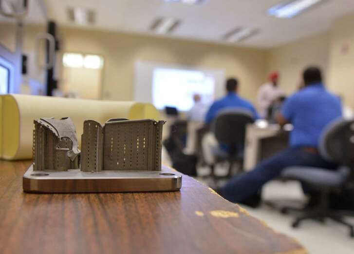 A sample of the 3D manufacturing process sits next to students in the Veterans Advanced Manufacturing Bootcamp at St. Phillip's College Norris Technical Building Monday.
