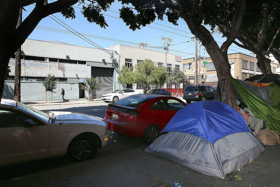 Tents are set up across the street from MacNeil's building on 16th Street. He and other merchants hope the city will pay attention to the data they collect. Photo: Liz Hafalia, The Chronicle