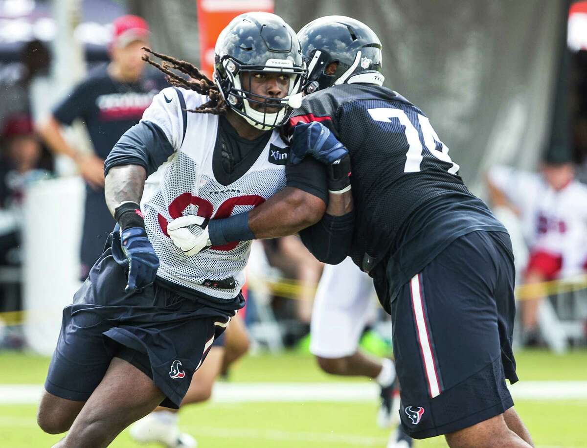 Jadeveon Clowney, left, is tipping the scales at 265 pounds as training camp begins, compared with as much as 284 in the past.