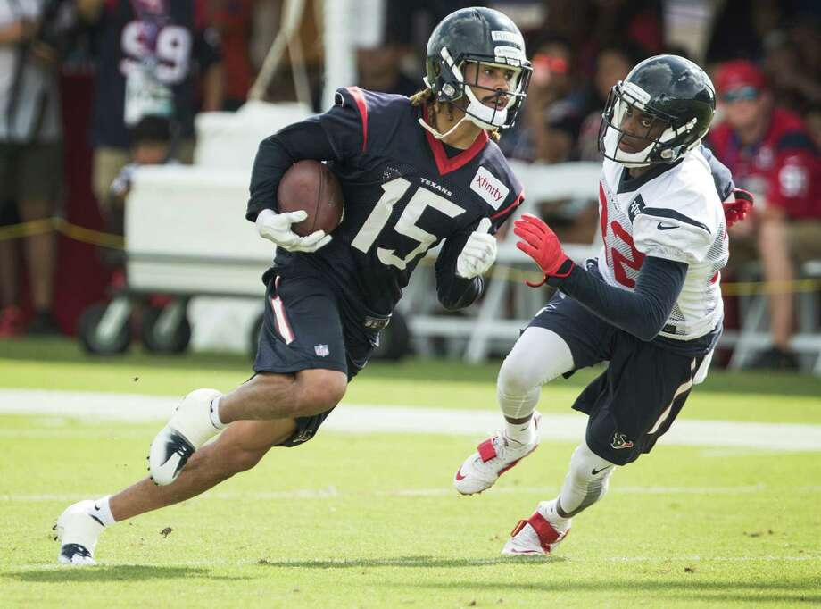 Texans rookie wide receiver Will Fuller (15) gets a chance to use his blazing speed against defensive back Robert after making a catch. Photo: Brett Coomer, Staff / © 2016 Houston Chronicle