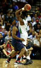 USA Basketball Men's National Team's Kyle Lowry left, and Nigerian National Team's Benjamin Uzoh right, face off during the first quarter of the USA-Nigeria exhibition game at the Toyota Center Aug. 1, 2016, in Houston.
