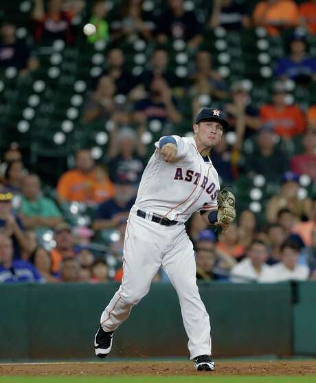 HOUSTON, TX - AUGUST 01:  Alex Bregman #2 of the Houston Astros makes a catch on a high chop to retire Darwin Barney #18 of the Toronto Blue Jays in the third inning at Minute Maid Park on August 1, 2016 in Houston, Texas. Photo: Bob Levey, Getty Images / 2016 Getty Images