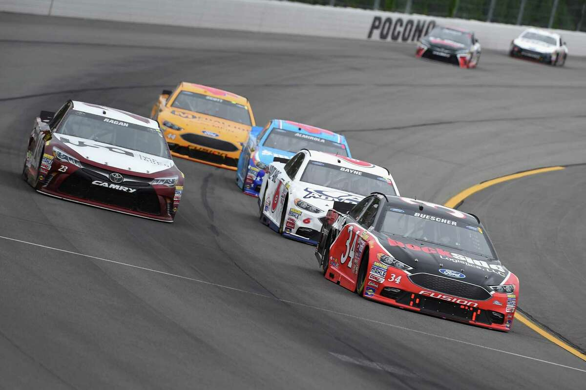 LONG POND, PA - AUGUST 01: Chris Buescher, driver of the #34 Dockside Logistics Ford, leads a pack of cars during the NASCAR Sprint Cup Series Pennsylvania 400 at Pocono Raceway on August 1, 2016 in Long Pond, Pennsylvania. The race was delayed due to inclement weather on Sunday, July 31. (Photo by Josh Hedges/Getty Images) ORG XMIT: 657835275
