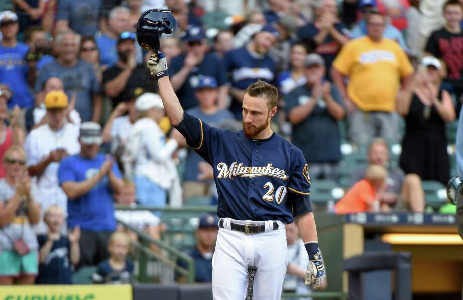Milwaukee Brewers' Jonathan Lucroy tips his cap after getting a standing ovation from fans while pinch-hitting during the eighth inning of a baseball game against the Pittsburgh Pirates on Sunday, July 31, 2016, in Milwaukee. Lucky stopped a trade to the Cleveland Indians earlier in the day. (AP Photo/Benny Sieu) ORG XMIT: WIBS114 Photo: Benny Sieu / FR171242 AP