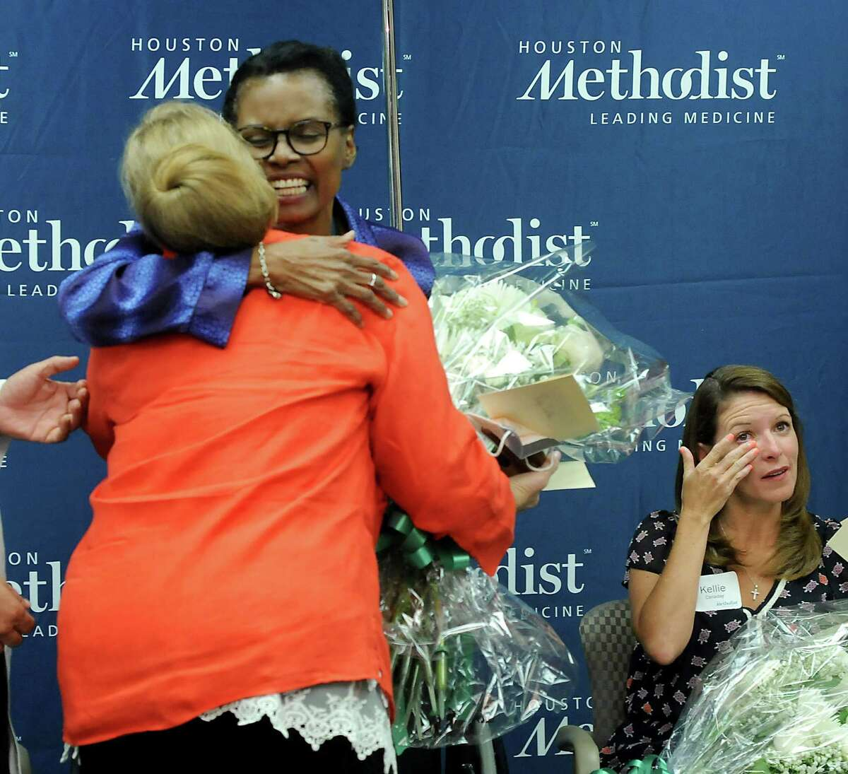 The six-way kidney swap Monday at Houston Methodist Hospital proved to be an emotional moment for donors, including Dana Edson, front left, and Kellie Canaday, right, as well as recipients like Rudyne Walker, center.