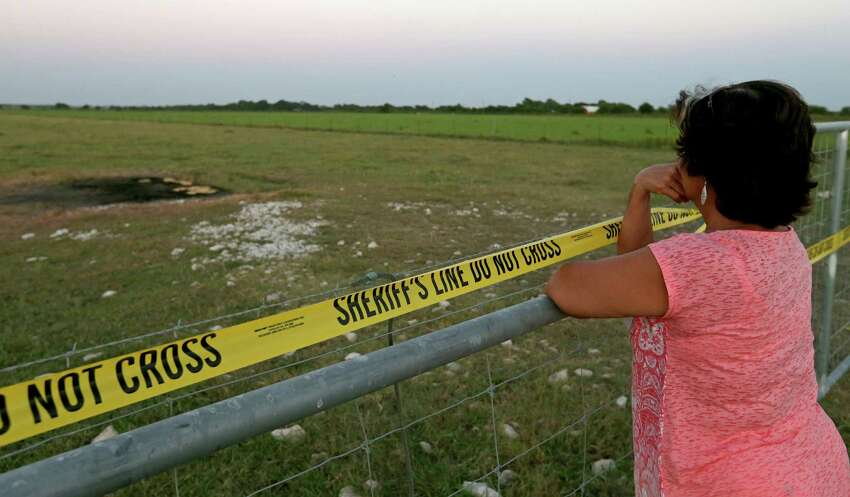 Kathy Stephens, of Kyle, Tx., views the site of a hot air balloon crash, Monday Aug. 1, 2016, that killed 16 people on Saturday July 30, 2016 near Maxwell, Texas in Caldwell County.