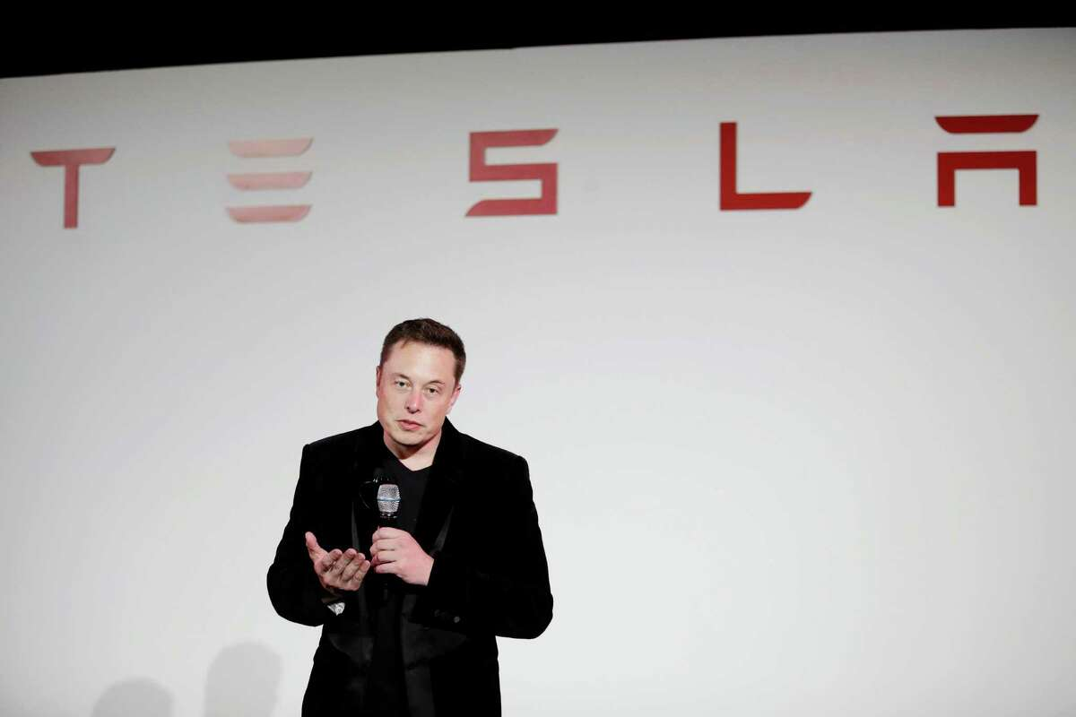 FILE - In a Sept. 29, 2015 file photo, Elon Musk, CEO of Tesla Motors Inc., talks about the Model X car at the company's headquarters, in Fremont, Calif. On Monday, Aug. 1, 2016, Tesla and SolarCity announced they have entered into an agreement under which Tesla will acquire SolarCity. Tesla will pay approximately $2.6 billion for solar panel maker SolarCity in an all-stock deal. (AP Photo/Marcio Jose Sanchez, File)