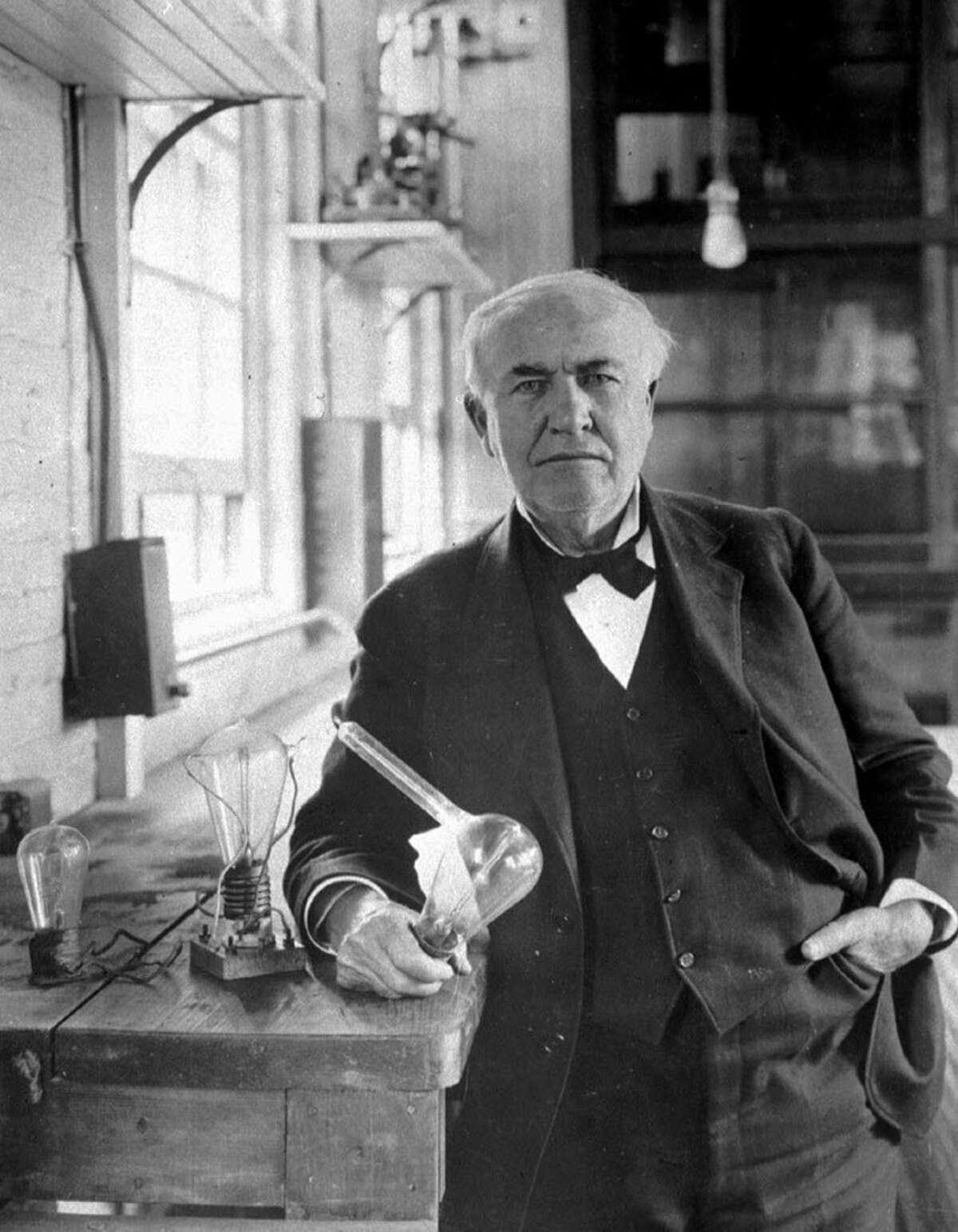 Thomas Alva Edison, who developed the first electric light bulb, is shown in his laboratory in West Orange, N.J., in this undated photo. Edison holds the