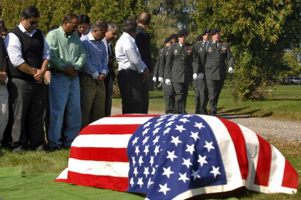 An honor guard from the 10th Mountain Division of Fort Drum approaches  the casket of 1st Lt. Mohsin Naqvi, killed in Afghanistan by a roadside bomb on September 17, 2008, during his burial service on Monday, Sept. 22, 2008, in Colonie, N.Y.  (Philip Kamrass/Times Union archive)