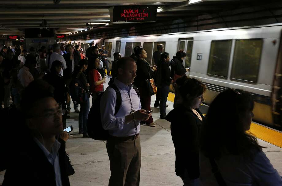 People walk and wait for a train at the Embarcadero BART station in this file photo from May 4, 2016 in San Francisco, Calif. Passengers on Tuesday saw a gaggle of Bart Simpsons ride a BART train in San Francisco. Photo: Leah Millis, The Chronicle