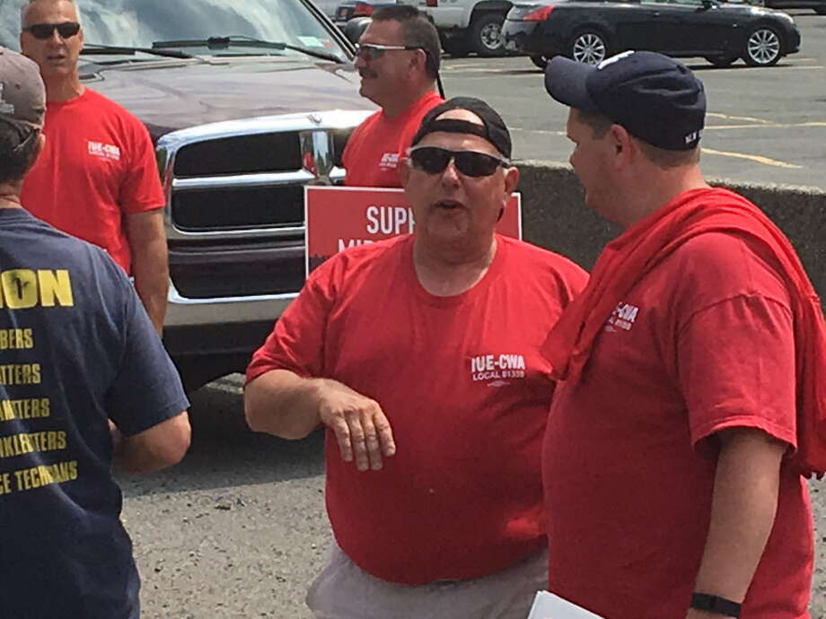 Dom Patrignani, center, at a union rally held in front of the Momentive Performance Materials factory in Waterford on Friday afternoon. The event was held in advance of contract talks that begin next week.