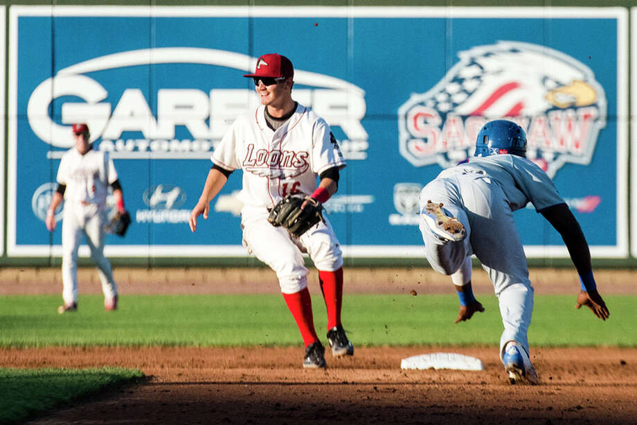DANIELLE McGREW TENBUSCH | for the Daily News Great Lakes Loons infielder Chris Powell waits for the throw as South Bend's Andruw Monasterio approaches second baseat Dow Diamond in Midland on Monday. The South Bend Cubs beat the Great Lakes Loons 5-1.