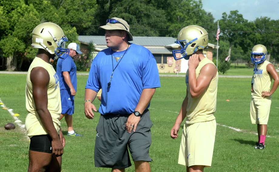 Hamshire-Fannett's Bill Jehling works with players during the season's first day of practice on Monday. Photo taken Monday August 01, 2016 Guiseppe Barranco/The Enterprise Photo: Guiseppe Barranco, Photo Editor