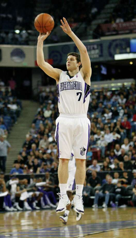 Sacramento Kings guard Jimmer Fredette hits an open three point shot against the Minnesota Timberwolves  during the second half of an NBA basketball game in Sacramento, Calif., Monday, April 2, 2012. The Kings won 116-108.(AP Photo/Steve Yeater) Photo: Steve Yeater / FR69238 AP
