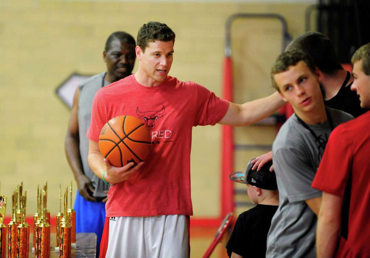 Former Glens Falls High basketball star Jimmer Fredette talks with players at the Glens Falls High School during the Jimmer Jam Basketball Camp on Tuesday, July 1, 2014, in Glens Falls, N.Y. Fredette will be playing with the the Chicago Bulls this season. (Paul Buckowski / Times Union)