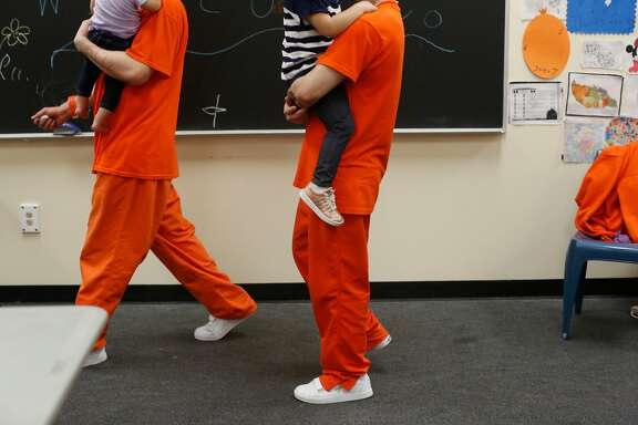 Inmates at County Jail #5 carry their children as they visit with them  during a Community Works One Family visit on Saturday, June 4, 2016 in San Francisco, California.