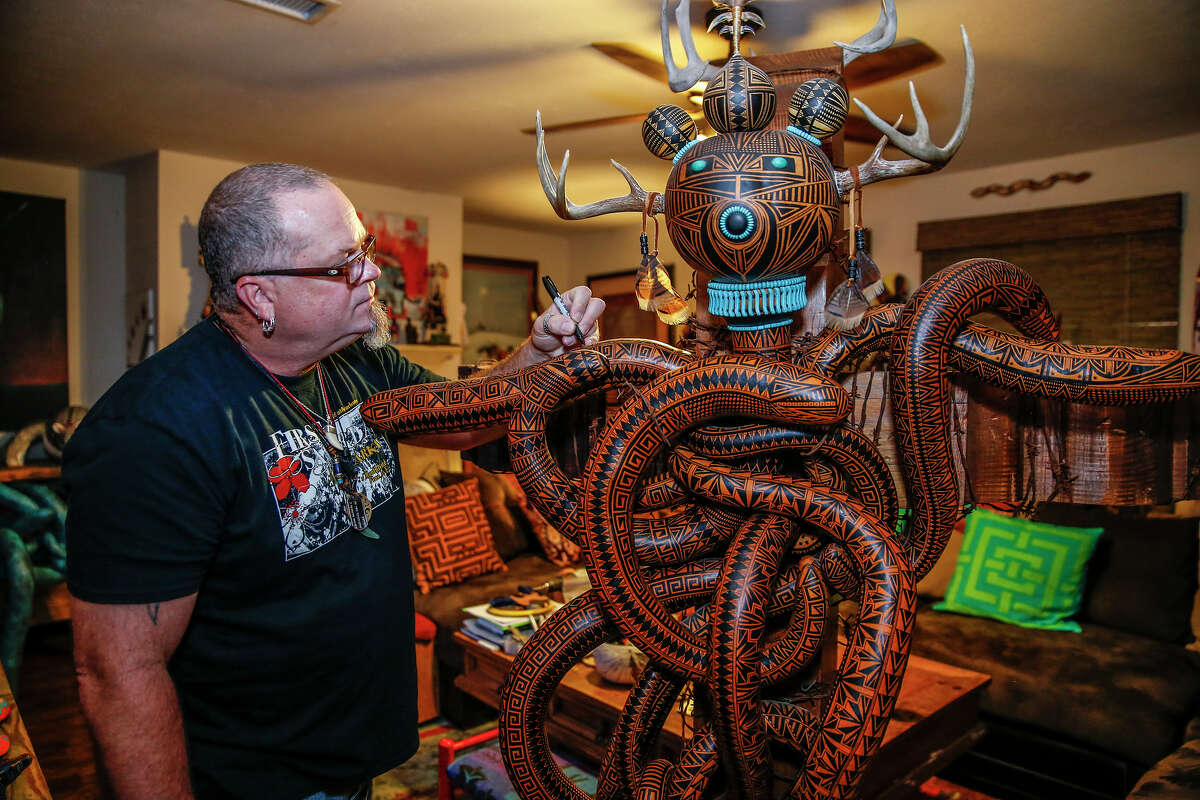 """Katy artist Mike Peyton uses a Sharpie marker to draw intricate designs on large works made of gourds. """"I just want to make stuff,"""" he said. """"This is what I really want to do."""""""