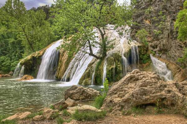 DAVIS, OKLAHOMA    There's a reason Turner Falls Park is a favorite swimming hole for locals: It's home to an impressive 77-foot tall waterfall that you can swim underneath. After taking a dip, explore the rock castle that was built into the hillside nearby.