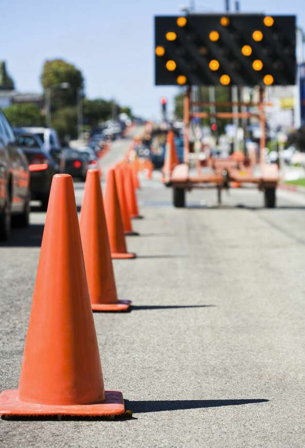 Close up of traffic cones on busy street Photo: PBNJ Productions/Getty Images/Blend Images