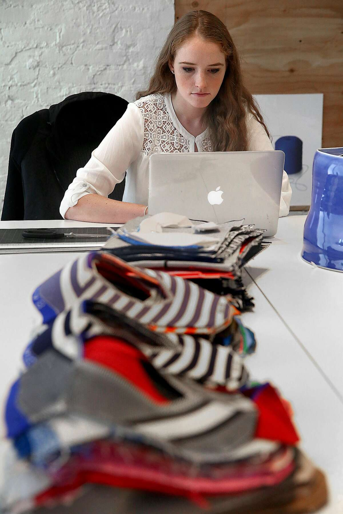 Graphic designer Ashlee Rice works at Rothy's, a female shoe brand, on Thursday, July 28, 2016, in San Francisco, Calif.
