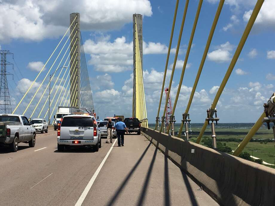 Port Arthur Police and the U.S. Coast Guard are responding to reports of a jumper at the Veterans Memorial Bridge Tuesday. Photo: Sara Flores/The Enterprise